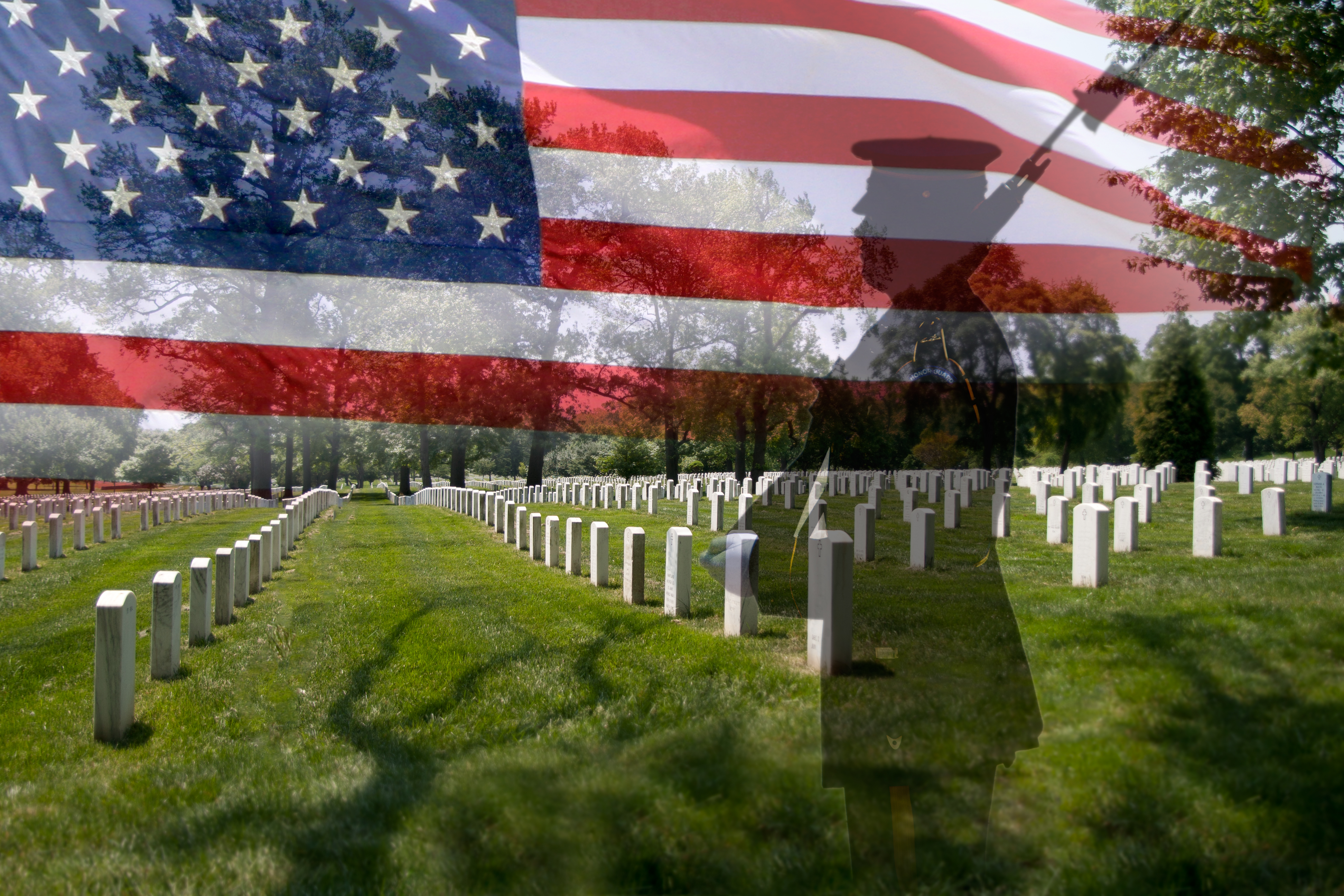Soldier silhouette, american flag and grave stones.